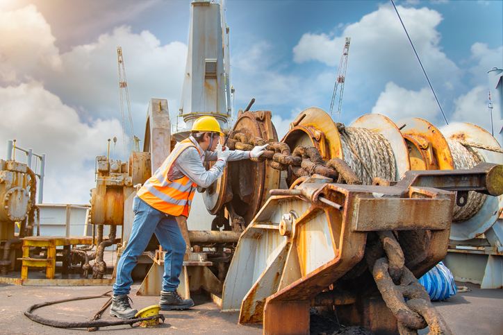 engineering or worker, motor man, loading master or controller working in communication by walkie talkie to team for safety loading winch of the crane, lifting gear operation in industrial at work