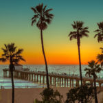 Palm trees on Manhattan Beach at sunset. Vintage processed. Fashion travel and tropical beach concept.